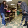 Tribune-Star/Jim Avelis<br /> Variety: Danielle Worley helps Lynn's Boutique customer Andrea McGrath select a pair of boots.