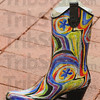 Tribune-Star/Jim Avelis<br /> Made for walking: A colorful boot is showcased, with several others, in the front window of the newly opened Lynn's Boutique in the old Book Nation in downtown Terre Haute.