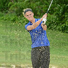 Tribune-Star/Jim Avelis<br /> Out of trouble: Indiana State University golfer Christina Beyerl practices her shots from the sand during practice last week.