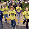 Tribune-Star/Joseph C. Garza<br /> Walking for awareness: Stephen Koos, center, a Terre Haute North junior, walks with his fellow National Honor Society members as they participate in the Homeward Bound walk Saturday on the Indiana State University campus.
