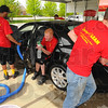 Tribune-Star/Jim Avelis<br /> Many hands: A work crew details a car brought in to Spring Clean Turbo Car Wash on South 7th street. Owner Tom Thompson is now offering 3 levels of detailing along with touchless car washes.