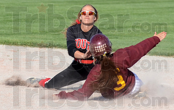 Tribune-Star/Jim Avelis<br /> No give: Terre Haute South shortstop Kelsey Marlow guards second base, tagging out a Bloomington North base runner on an attempted steal.