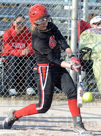 Tribune-Star/Jim Avelis<br /> Help yourself: Terre Haute South's Cheyenne Reinig gets an RBI hit early in the Braves game with Bloomington North Wednesday evening.