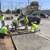 Tribune-Star/Jim Avelis<br /> Foot traffic: A Feutz Construction crew lays a concrete sidewalk along the north side of Margaret Avenue, west of 7th street, Wednesday afternoon.