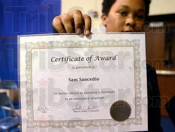 Tribune-Star/Joseph C. Garza<br /> From the Mayor: Sam Sancedio displays the certificate presented to him by Mayor Duke Bennett Wednesday at Deming Elementary School.