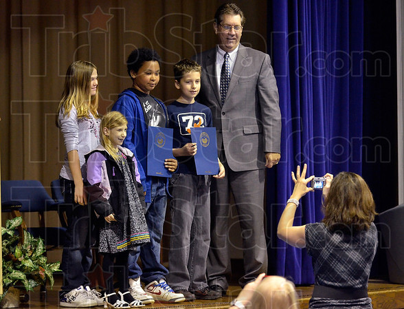 Tribune-Star/Joseph C. Garza<br /> One for the scrapbook: Deming Elementary School first-grader Katelyn Newell, front, poses for a photo with fifth-graders Brooklyn Shelton, Sam Sancedio and Aaron Myrtle and Mayor Duke Bennett after the mayor recognized the trio of fifth-graders Wednesday for their quick response after Newell collapsed in the hallway recently.