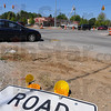 Tribune-Star/Jim Avelis<br /> Slow going: Traffic eases into the intersection at 7th and Margaret Avenue Wednesday afternoon. Ongoing construction and rough pavement keep speeds down.