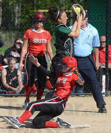 Tribune-Star/Jim Avelis<br /> Safe at home: Terre Haute South pinch runner Holly Jones scores as West Vigo catcher Alainie Shepard takes a late throw. The run was the first of the game for either team.