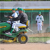 Tribune-Star/Jim Avelis<br /> Manicured: West Vigo head baseball coach Steve DeGroote drags the infield while his team does the detail work on the mound and base paths after their win over North Vermillion last week.