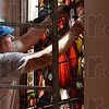 Tribune-Star/Joseph C. Garza<br /> Illuminated art: Leroy Thornburg of Bovard Studio, Inc., fits a piece of stained glass into a frame in one of the windows in the Church of the Immaculate Conception Wednesday at St. Mary-of-the-Woods.