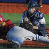 Tribune-Star/Jim Avelis<br /> Waiting: Terre Haute North catcher Luke Schoffstall waits at home for McCutcheon baserunner Mason Bruce. Schoffstall tagged Bruce out on the play.