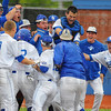 Tribune-Star/Jim Avelis<br /> Welcome home: Indiana State's Ryan Walterhouse(unseen) is swarmed by teammates as he reaches home plate. Walterhouse hit a walk-off two run home run to end the Sycamore's game with visiting Nebraska Omaha. The three game series continues today.