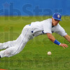 Tribune-Star/Jim Avelis<br /> Got it: Indiana State shortstop Koby Kraemer launches himself after a ground ball in the Sycamore's game with visiting Nebraska Omaha Friday evening.