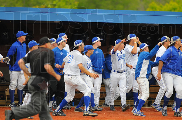 Tribune-Star/Jim Avelis<br /> It might be: The Indiana State bench watches and waits for Ryan Walterhouse's hit to clear the left field fence before erupting.