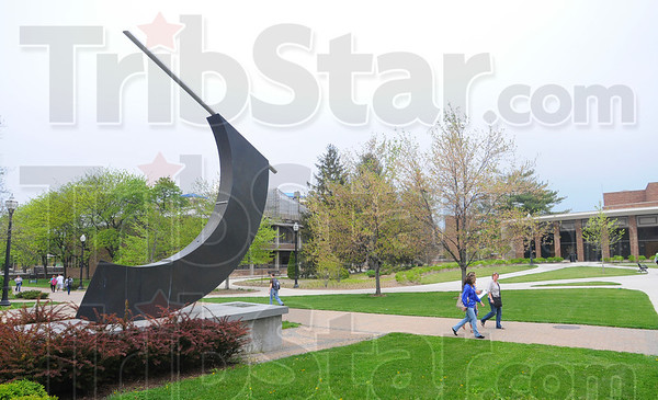 Tribune-Star/Jim Avelis<br /> Scientific sculpture: Students walk by Stalker Hall and its artwork Wednesday afternoon. The work marks the passing of the seasons, marking summer and winter solstices as well as Spring and Fall Equinoxes.