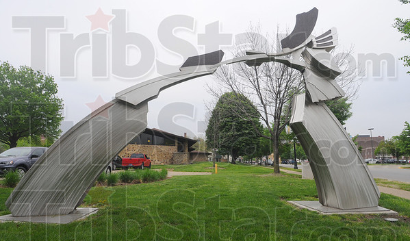 Tribune-Star/Jim Avelis<br /> Enter here: The stainless steel and stone sculpture on the grounds of the Vigo County Public library invites visitors into the downtown from the south side of Terre Haute.