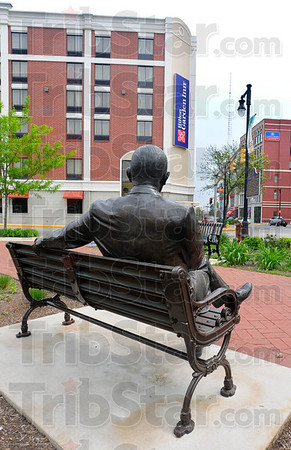 Tribune-Star/Jim Avelis<br /> Accommodating: The bronze of Terre Haute native Max Ehrmann looks east toward the two downtown hotels at the Crossroads of America at 7th and Wabash.