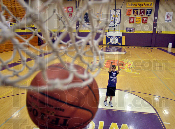 Count it: Solomon Ficklin shoots another successful free throw as he practices Friday, March 30 in the Sullivan High School gymnasium. Ficklin will compete in the Elks National Hoop Shoot 12-13 age division from April 26-29 in Springfield, Mass., one of a select few out of about three million participants ages 8-13.