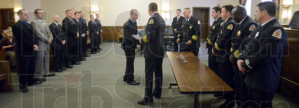 Badge: Terre Haute Fire Chief Jeff Fisher presents badges  to the newest members of the Fire Department Monday afternoon at City Hall.