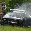 Tribune-Star/Jim Avelis<br /> Car fire: A late model Ford Mustang burst into flames in an afternoon accident at Indiana 42 and Tabortown Road. Two people were taken to ambulances.