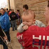 Tribune-Star/Joseph C. Garza<br /> This one will be fed: Bobbie Murphy holds her son, three-month-old Michael DeBouse, as she waits in line for the Feed the Children food distribution Wednesday at Covenant Cooperative Ministry at 122 South 10 1/2 Street.