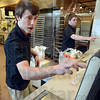 Teen: Blake Bradford (L) and Craig Helman work as cashiers at the Bakery entrance to Baesler's Monday afternoon.