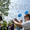 "Tribune-Star/Joseph C. Garza<br /> Two for ""Ziggy"": Jodi Montgomery saves two balloons for her son, Zackary ""Ziggy"" Montgomery, far left, to release during Bridges of Indiana's ""Be A Piece of the Puzzle"" Balloon Sendoff at Deming Park Monday."