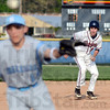 Runner: North's #23, Zach Milam runs toward third base as the ball is hit past a Shakamak infielder Monday evening.