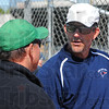 Tribune-Star/Jim Avelis<br /> Pre-game chat: West Vigo tennis coach Doug Tilford, left, talks with Terre Haute North girl's coach Jeff Farmer before the girl's match Tuesday afternoon on the Viking's courts.