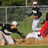 Tribune-Star/Jim Avelis<br /> Safe: Terre Haute South baserunner Spencer Whitlock beats the throw to South Vermillion shortstop Kaden Lawson for a stolen base. The Braves put up 11 runs in the first two innings.