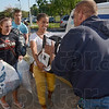Tribune-Star/Joseph C. Garza<br /> Spreading goodwill: Terre Haute South students Kayla Ennen, Thomas King and Molly Nasser carry donated clothing to Dan Davis of Goodwill Industries Tuesday at the school.