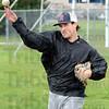Warmup: Cody Gardner throws during Monday's practice at Don Jenning Field.