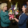Tribune-Star/Joseph C. Garza<br /> Bouquet for our guest: Lt. Gov. Becky Skillman accepts a bouquet of flowers from Kylee Yocum, the daughter of Vermillion County Republican Chairman, Tim Yocum, right, Thursday at the L & L Castle in Clinton.