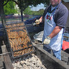 Tribune-Star/Jim Avelis<br /> Getting there: Paul Ingle tends to the brats at the 35th Oblerlandler Strassenfest Thursday afternoon. The event runs through Saturday and is located in the Clabber Girl Festival Marketplace.