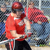 Tribune-Star/Jim Avelis<br /> Big hit: Mackenzie McGregor rips a three run double up the middle of the North Central defense in second inning action on the Braves diamond Thursday evening.