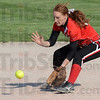 Tribune-Star/Jim Avelis<br /> Sure hands: Terre Haute South second baseman Brianna Price scoops up a ground ball early in the Braves game with North Central.