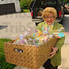 Tribune-Star/Jim Avelis<br /> More to come: Alice Stapleton carries a box full of Easter baskets into Happiness Bag Tuesday afternoon. Her late husband Ed hosted Easter Egg hunts at Collett Park for years before he passed away last year.