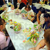 Tribune-Star/Jim Avelis<br /> Early Easter: Clients and staff at the Happiness Bag look over Easter baskets brought by the Stapleton family, a continuation of the tradition started by Ed Stapleton when he hosted Easter Egg hunts at Collett park.