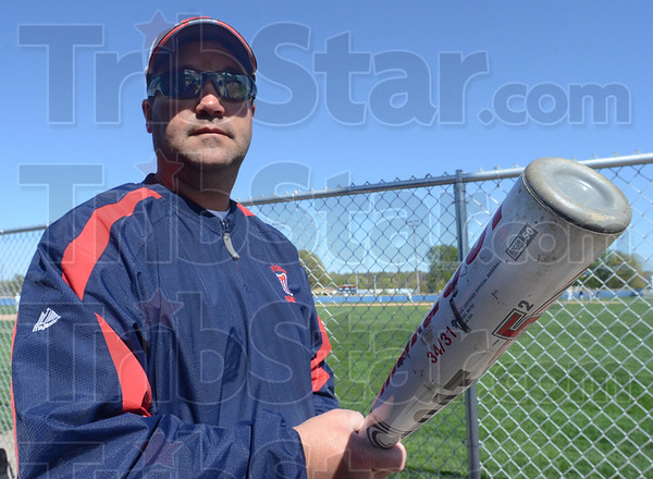"Tribune-Star/Jim Avelis<br /> New rules: Terre Haute North baseball coach Shawn Turner holds on of the new ""deader"" bat required for all high school contests."