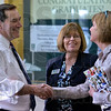 Tribune-Star/Joseph C. Garza<br /> Meeting the ones who educate our workforce: U.S. Senate candidate Joe Donnelly greets Ivy Tech Corporate College of the Wabash Valley Executive Director Lea Anne Crooks as Leslie Stultz, dean of liberal arts & sciences and the school of education, looks on Tuesday during a tour of the college.