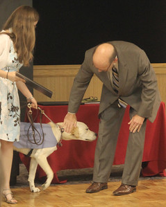 Dr. Bonner congratulating Tucker on his Who's Who Dog Award
