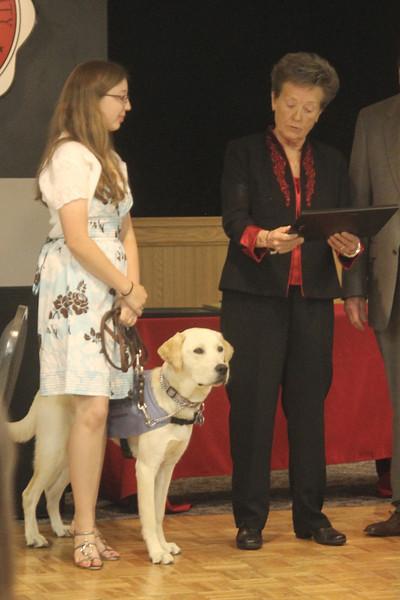 Tucker receiving his Who's Who Dog Award