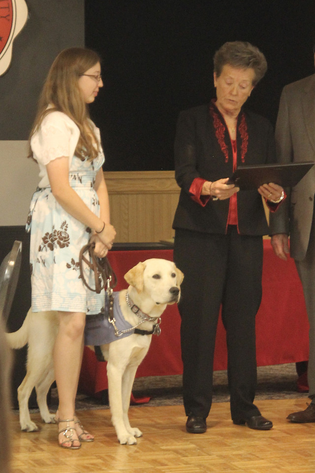 Tucker receiving his Who's Who Dog Award