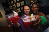 "Carla Changwailing and her concoction, ""Hibiscus Sour,"" with her friend who helped mix the drinks for guests, Shareena Casterline.  ""The Art of Mixology,"" benefiting Culturehaus, at the Artwork Network in Denver, Colorado, on Saturday, April 7, 2012.<br /> Photo Steve Peterson"
