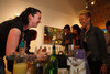 """Courtney Wilson, with Williams & Graham, created a drink called """"Gin Basil Smash,"""" and chats with Heidi McGuire.  """"The Art of Mixology,"""" benefiting Culturehaus, at the Artwork Network in Denver, Colorado, on Saturday, April 7, 2012.<br /> Photo Steve Peterson"""