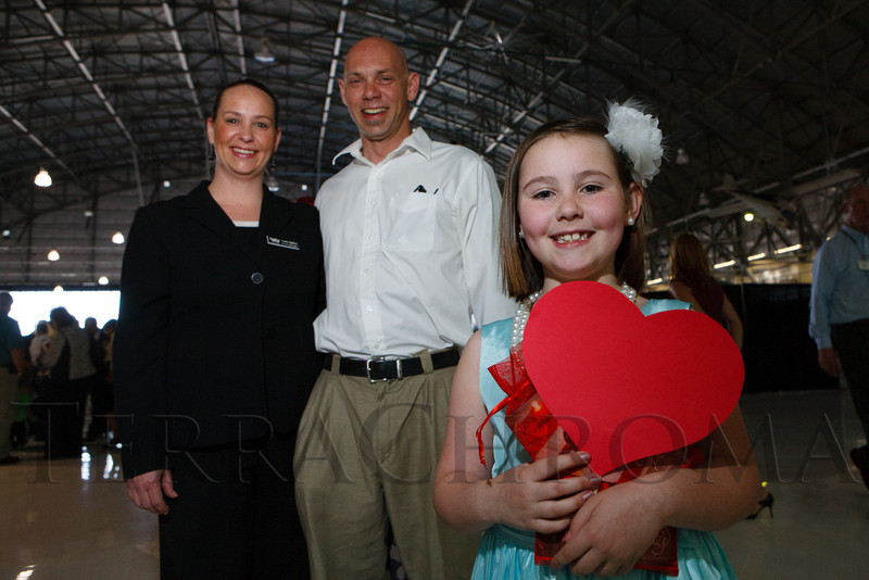 Laura and Guy Hylton with their daughter, Rivers.  The 2012 Little Hearts Luncheon & Fashion Show, benefiting Children's Hospital Colorado Heart Institute, at Wings Over the Rockies Air & Space Museum in Denver, Colorado, on Friday, April 13, 2012.<br /> Photo Steve Peterson