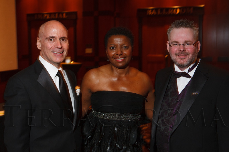 Hank Provost (left), Faye Wilson Tate, and Christopher Adkins.  The 2012 HRC Mile High Gala, benefiting Human Rights Campaign Colorado, at the Grand Hyatt Denver in Denver, Colorado, on Saturday, April 21, 2012.<br /> Photo Steve Peterson