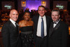 Senator Michael Bennet (second from right) with event co-chairs Hank Provost (left), Faye Wilson Tate, and Christopher Adkins.  The 2012 HRC Mile High Gala, benefiting Human Rights Campaign Colorado, at the Grand Hyatt Denver in Denver, Colorado, on Saturday, April 21, 2012.<br /> Photo Steve Peterson
