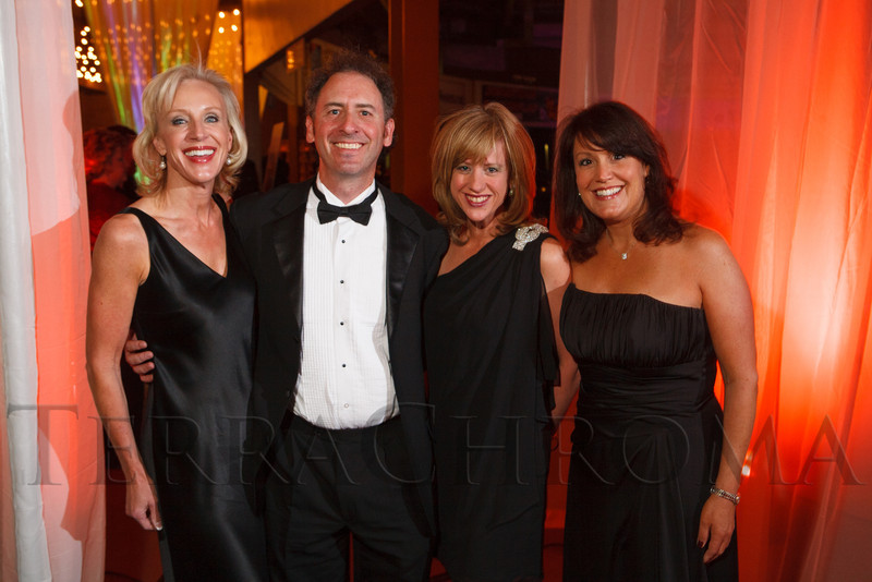 Ann McFarlane, Michael and Amy Friedman, and Lisa Biederman.  The 2012 NightShine Gala, benefiting the Denver Health Foundation, at the National Western Events Center in Denver, Colorado, on Saturday, April 28, 2012.<br /> Photo Steve Peterson