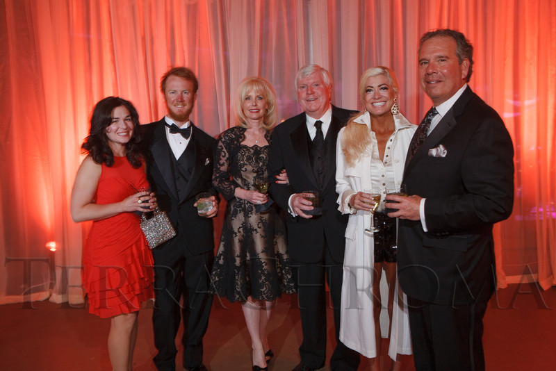 Angela and Seth Harney, Margaret and Jerry Hodge, Alicia Walls, and George Raffkind.  The 2012 NightShine Gala, benefiting the Denver Health Foundation, at the National Western Events Center in Denver, Colorado, on Saturday, April 28, 2012.<br /> Photo Steve Peterson